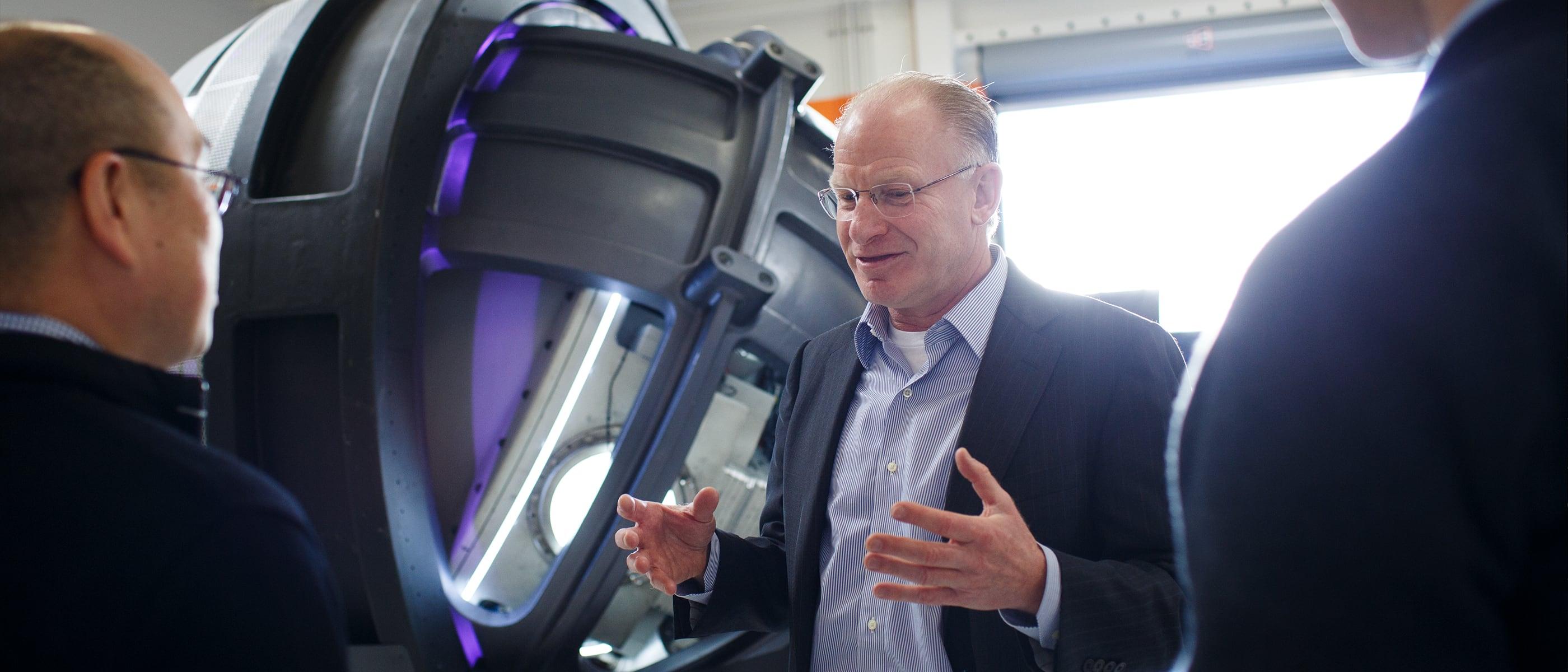 John R. Adler, MD, Founder & CEO