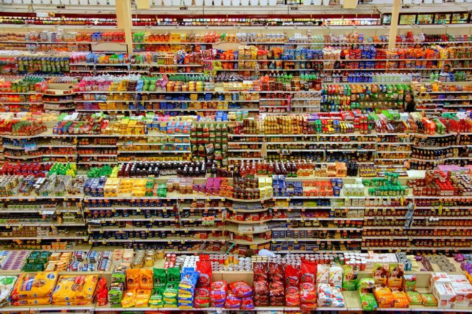 Wide angle photo of grocery aisles taken from a high vantage point.