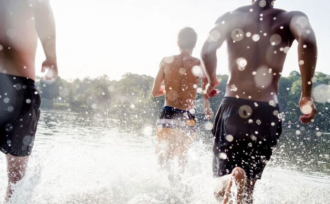 Renew Youth Brand Photography - Men running in shallow water