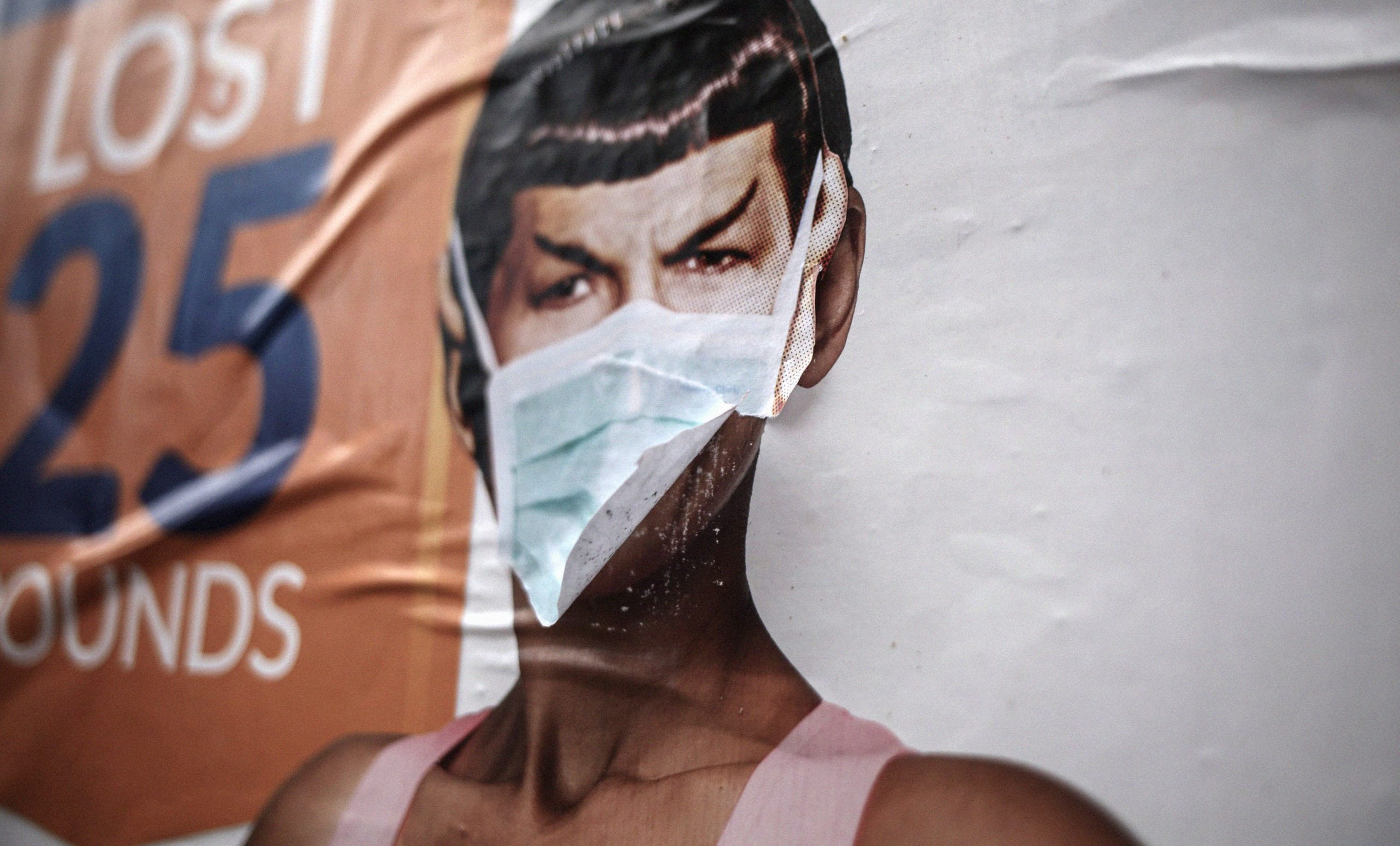 Poster bill on wall of Spock with surgical mask applied to face